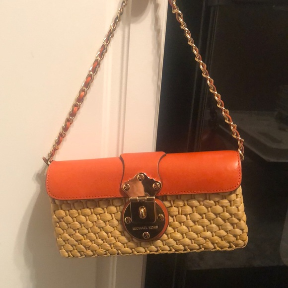 Authentic Michael Kors straw and leather clutch.